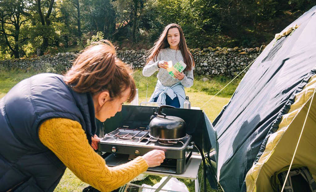A propane or butane camp stove is one of the best ways to boil water for coffee or tea on a camping trip.
